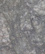 PR-May-14-2018: (DO-18-218) strongly fractured pale pink syenite with network of pyrite and/or fluorite-filled crackles, with sericitic haloes. Core diameters 47mm.